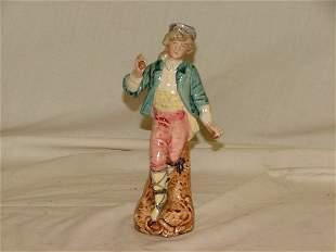 "7.5"" Majolica figure of boy standing, mino"
