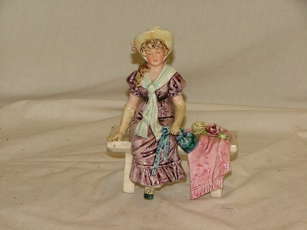 "7: 6.5"" Majolica figurine of girl sitting on"