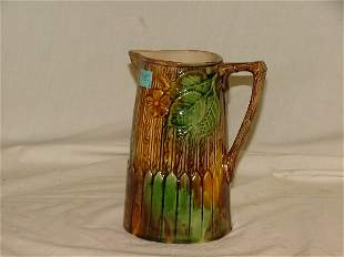 "7.25"" Majolica floral vase, brown and gree"