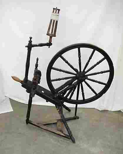 """Painted black spinning wheel with 25"""" w"""