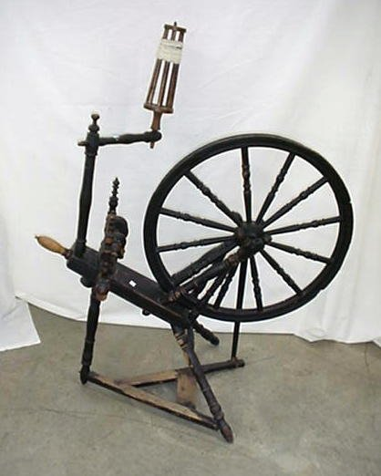 "1004: Painted black spinning wheel with 25"" w"