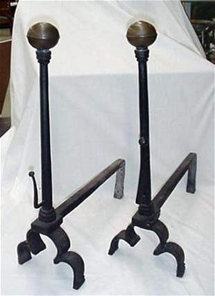 Pair of incised iron and brass firedogs