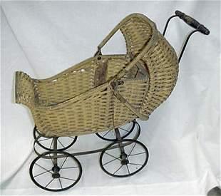 Child's wicker doll stroller, yellow pa