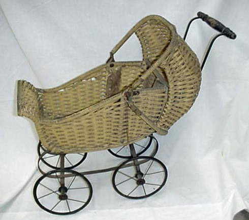 1024: Child's wicker doll stroller, yellow pa
