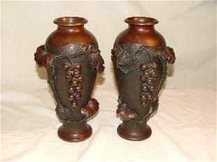 Pair of Japanese bronze vases with grap