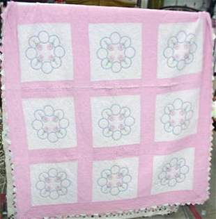 Pink and white hand sewn quilt #139