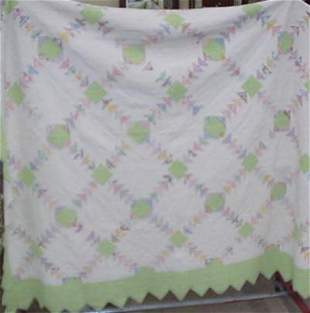 Green and white hand sewn quilt #140