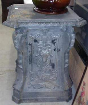 2 Cast iron urn bases with goat head an