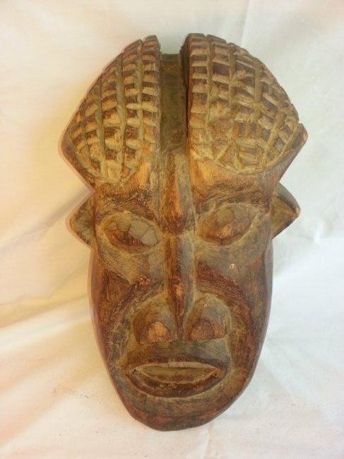 West African Carved Wood Helmet Mask