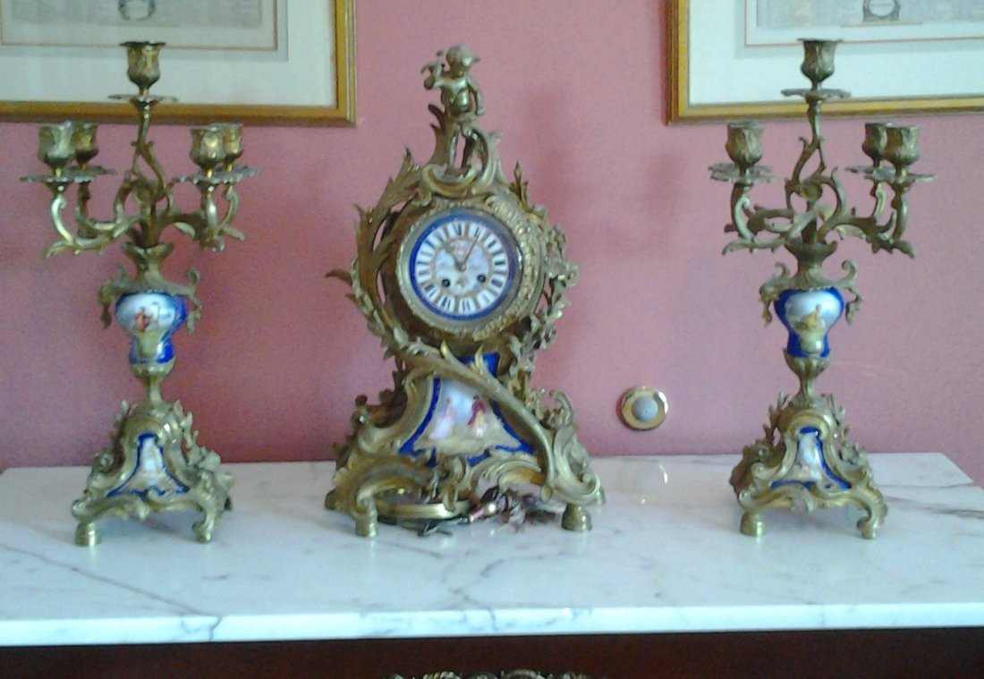 A French Gilt Brass and Porcelain Clock Garniture