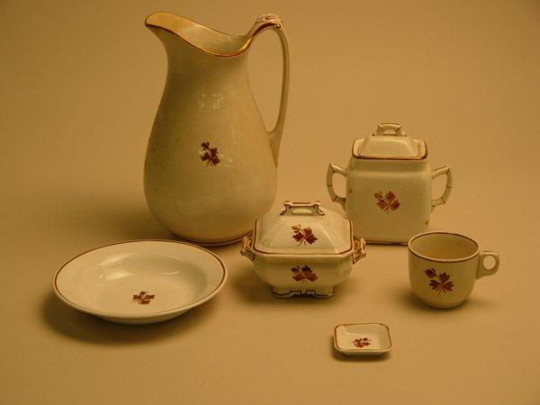 121: An Assembled Ironstone Partial Dinner Service Tea