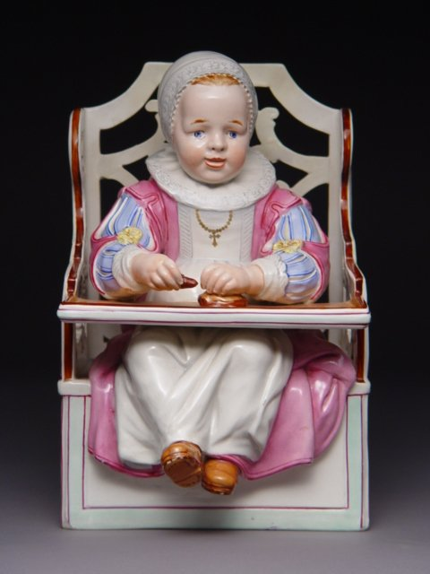 1019: Continental Porcelain Figure Child in High Chair