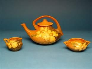 """Roseville Clematis Tea Set,burnt orang"