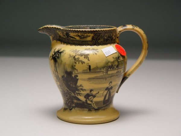 1009: Yellow Transferware Jug & Staffordshire Dog