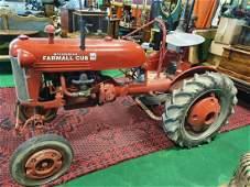 A vintage McCormick Farmall Cub Tractor. (1)(20/23) (No
