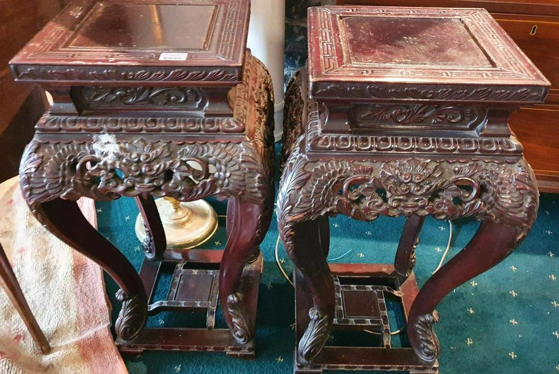 A pair of Oriental Hardwood highly carved Stands.  (2)