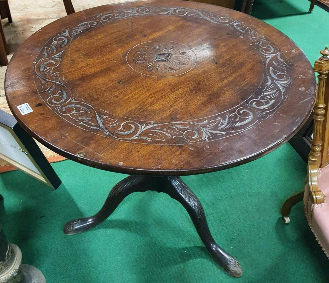 A Georgian Mahogany Supper Table with carved top. D