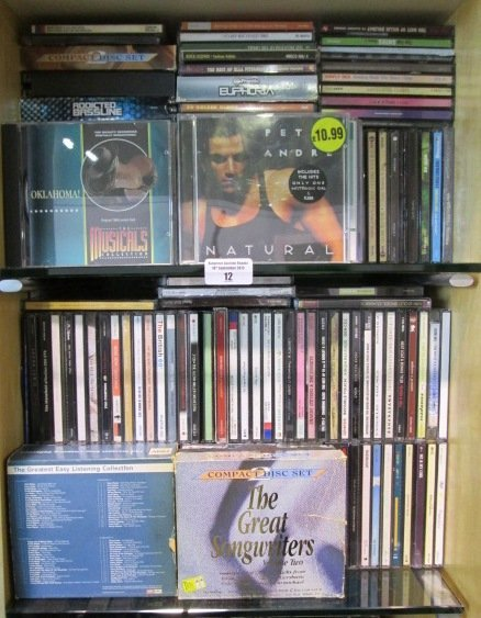 Two Shelves of CDs, artists including Sheryl Crow, Shan