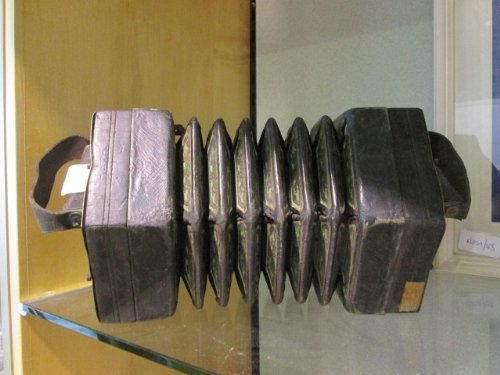 A C. Jeffries Concertina  with thirty-two bone buttons