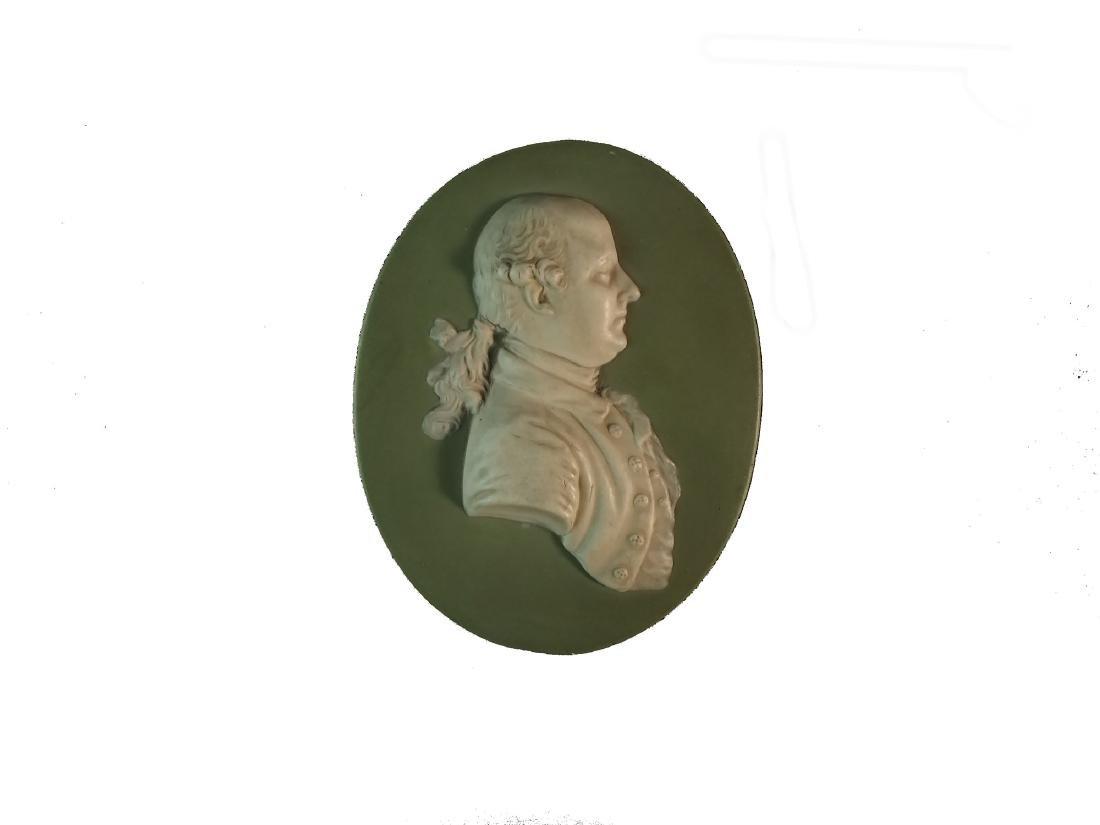 A Wedgwood green jasperware plaque of Thomas Bentley