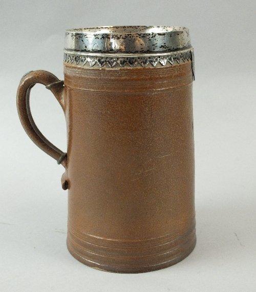 A brown salt-glazed tankard, circa 1700, of tall cylind