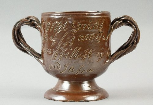 A brown salt-glazed loving cup, possibly Derbyshire mad