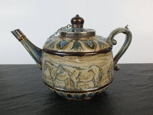 A Doulton Lambeth stoneware teapot and cover by Hannah