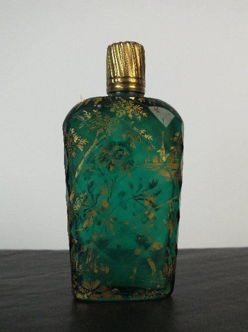 A James Giles green glass scent bottle, faceted flatten
