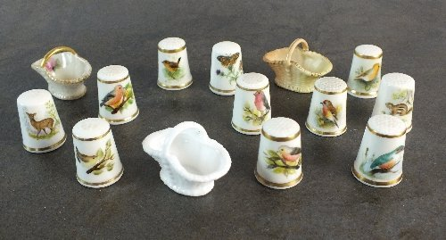 A collection of Royal Worcester thimbles, eight example