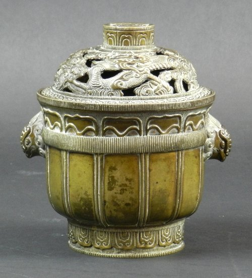 A Chinese bronze incense burner and cover, 18th century