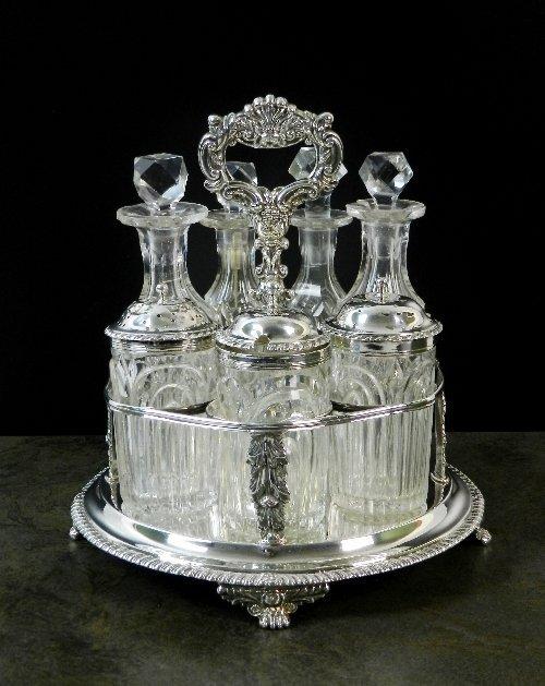 A George IV silver cruet stand, H*, London 1823, the