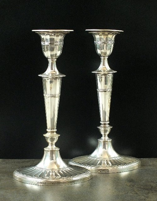 A pair of Adam style fluted candlesticks, Hawksworth