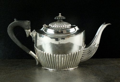 A silver teapot, makers mark rubbed, Chester 1912, of