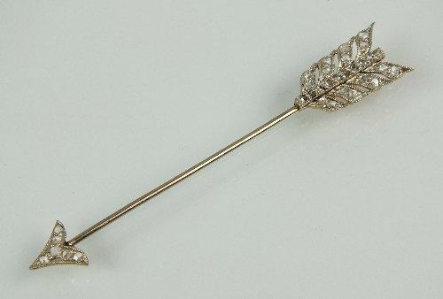 An early 20th century diamond set arrow pin, the arrow