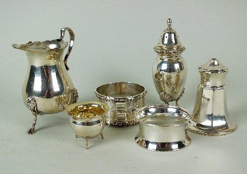 A silver cream jug, Birmingham, 9cm high, together with