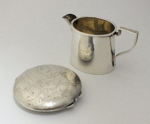 A small silver cream jug, Birmingham 1910, of oval form