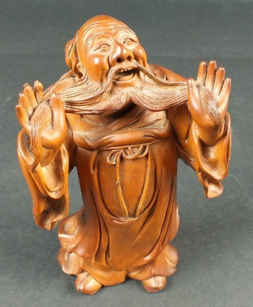 A carved boxwood figure of a monk, 19th century,