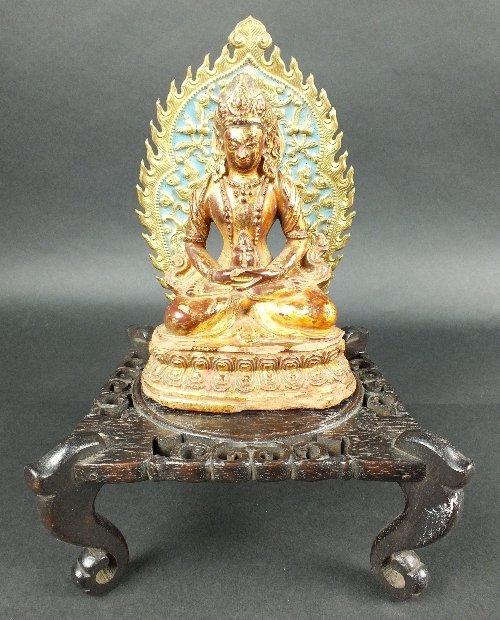A gilded terracotta buddha, 18th century, the figure