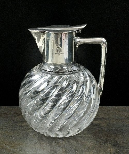 A Victorian silver mounted glass decanter in the style