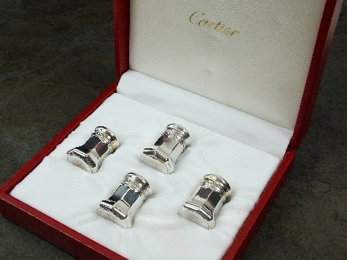 A cased set of four Cartier salt and pepper shakers,
