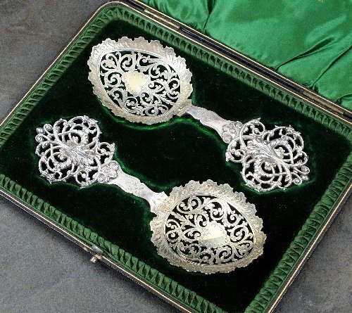 A cased pair of Victorian decorative silver spoons,
