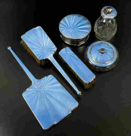 A matched six piece silver and blue guilloche enamel