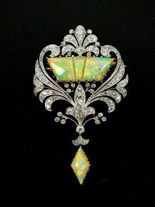 An early 20th century diamond and opal set brooch,