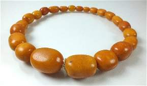 A graduated amber bead necklace, comprising