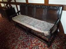 A late 17th/early 18th century oak settle, the leaf