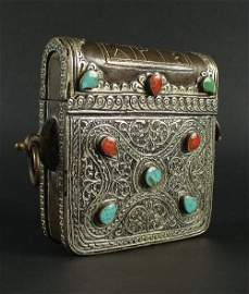 A Tibetan bronze and white metal hinged pouch, 20th
