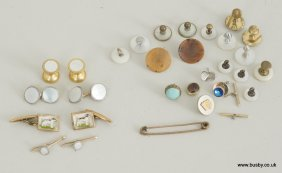 A collection of three sets of cufflinks including