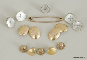 A collection of 9ct and 18ct gold buttons, cufflinks