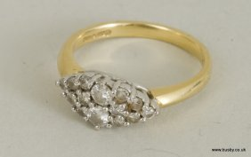 An 18ct and platinum mounted diamond cluster ring with