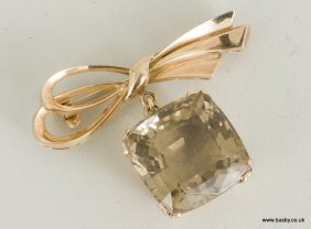A 14ct yellow gold ribbon brooch with large pendant